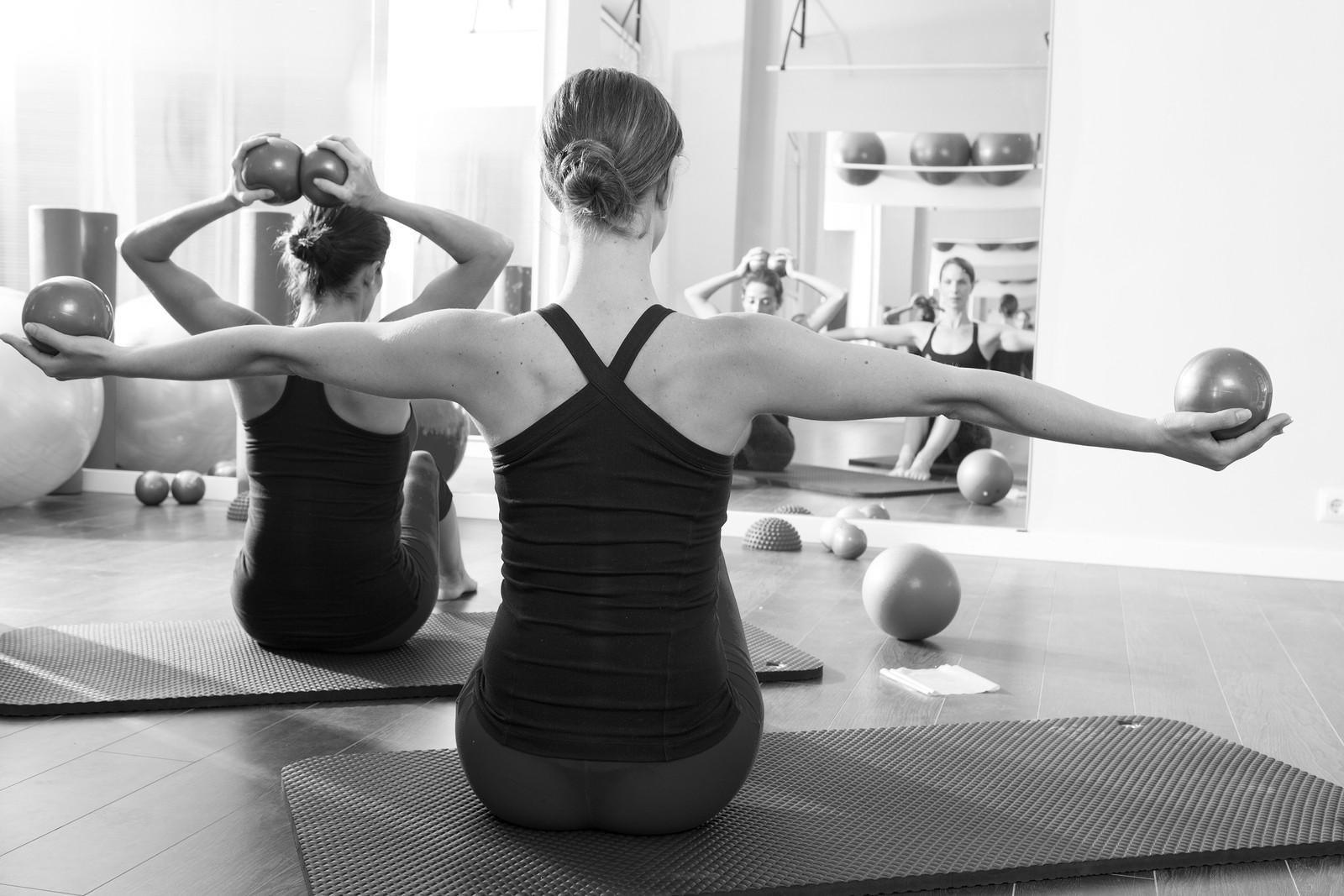 bigstock-Pilates-toning-ball-in-women-f-43125388